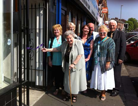 1 year ago - Mrs Adams, the first carer on the centre's database cut the ribbon to open the Derbyshire Carer's Association Centre on West Bars, watched by CEO Helen Robinson (centre) and other members at the centre.