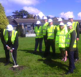 Local Councillor Graeme Baxter MBE turns the first turf...