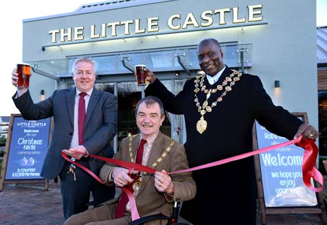 FESTIVE CHEERS -  Derbyshire County Council Chairman Councillor Steve Freeborn, centre, officially opens The Little Castle with Mayor of Chesterfield Councillor Alexis Diouf, right, and manager Rob Freeman.