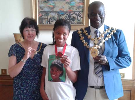 Johanna compares her Commonwealth Bronze 'bling' with the Mayor and Mayoress of Chesterfield