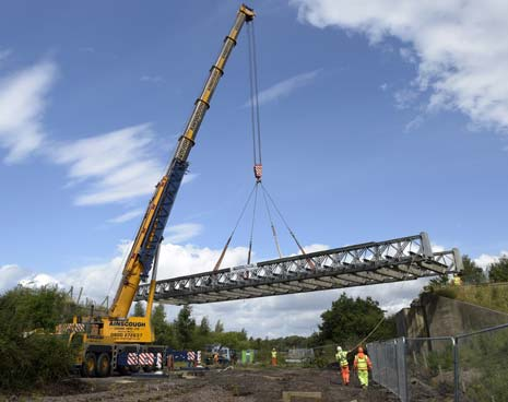 One of the country's largest cranes was in Derbyshire on Tuesday to remove a bridge deck as part of plans to expand Derbyshire County Council's flagship Markham Vale regeneration site.