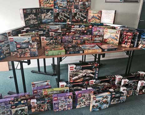 A haul of more than 200 boxes of Lego which were seized by police from a convicted shoplifter are being donated to children's charities.