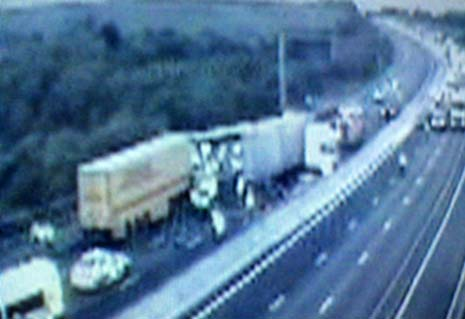 A lorry driver remains in a critical condition in hospital after a collision involving two HGVs shut the M1 for ten hours.