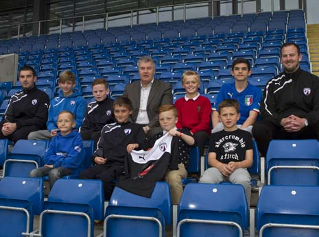 Back row, from left to right: Darren Molloy (Chesterfield FC Academy Coach), Connor Emery, Ryan Evans, Chris Turner (Chesterfield FC Chief Executive), Finlay Smith and Marcus Calderone. Front row, from left to right: Leighton Bowering, Fabian Oud, Bailey Smedley and Sam Sheppa